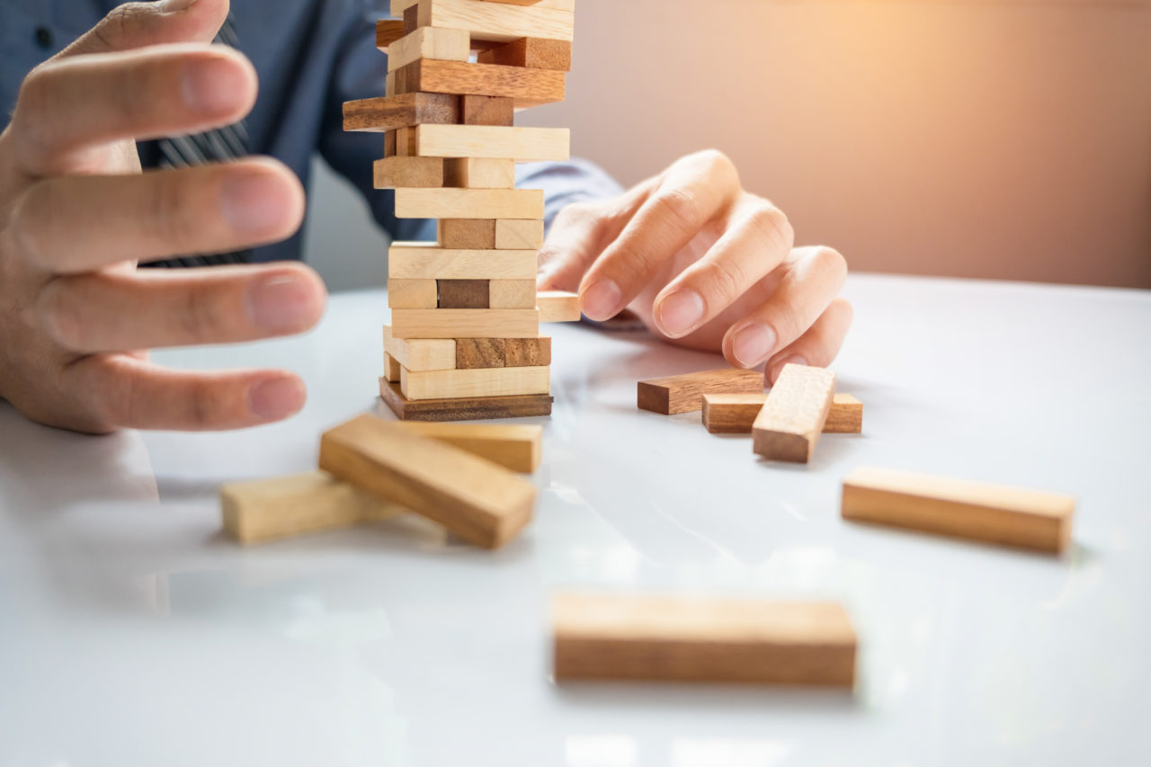 https://www.louisdavidbenyayer.com/wp-content/uploads/2020/10/planning-risk-and-strategy-in-business-businessman-gambling-placing-wooden-block-on-a-tower-1280x853.jpg
