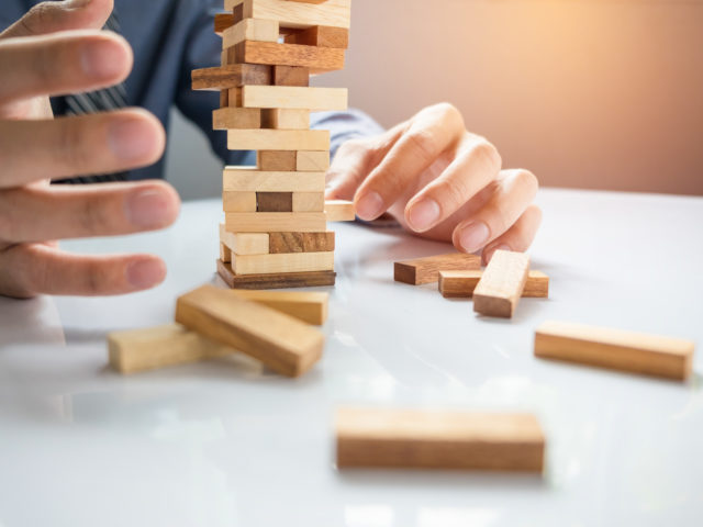https://www.louisdavidbenyayer.com/wp-content/uploads/2020/10/planning-risk-and-strategy-in-business-businessman-gambling-placing-wooden-block-on-a-tower-640x480.jpg